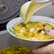 Fish soup with cheese - Stock Photo
