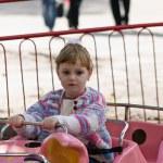 Girl on roller coaster — Stock Photo