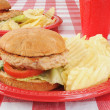 Turkey burgers on a picnic table — Stock Photo