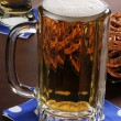 Mug of beer and pretzels — Stock Photo
