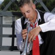 Musician playing trumpet — Stock Photo