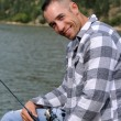 Happy man fishing — Stock Photo