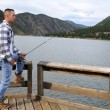 Man fishing at the lake — Stock Photo