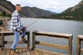 Man fishing at the lake — Stock Photo