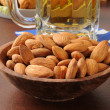 Wooden bowl of almonds — Stock Photo