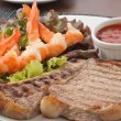 Stock Photo: Grilled rib steak close up with shrimp