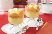 Cups of vanilla pudding — Stock Photo
