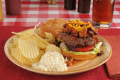 Chili cheeseburger with chips and coleslaw — Stock Photo