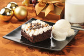 Christmas brownie and ice cream — Stock Photo