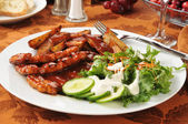 Barbecue ribs with potato wedges — Stock Photo