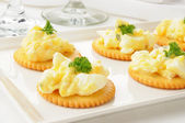 Egg salad on crackers — Stock Photo