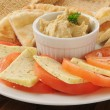 Hummus iwth tomato, cheese and pita bread — Stock Photo