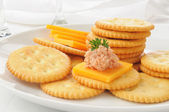 Ham and cheese on crackers — Stock Photo