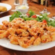 Cheese tortellini with salad — Stock Photo #15745193
