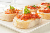 Burschetta on Italian toast — Stock Photo