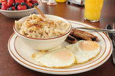 Sausage and eggs with oatmeal — Stock Photo