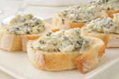Spinach artichoke dip on Italian toast — Stock Photo