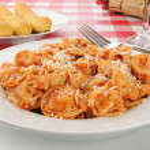 Tortellini and breadsticks — Stock Photo #16928371