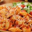 Stock Photo: Cheese tortellini with tomato sauce