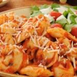 Cheese tortellini with tomato sauce — Stock Photo #17135087