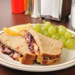 Stock Photo: Peanut butter and jelly sandwich with milk