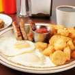 Sausage and eggs with hash browns — Stock Photo