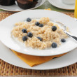 Stock Photo: Oatmeal with blueberries