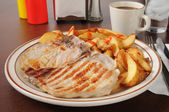 Grilled pork chops with home fries — Stock Photo