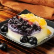 Blueberry peach panna cotta - Stock Photo