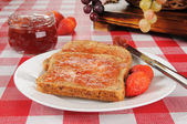Strawberry jam on sprouted wheat toast — Stock Photo