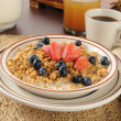 Granola with blueberries and strawberries — Stock Photo