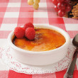 Stock Photo: Creme Brulee with raspberries