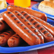 Picnic plate of grilled hot dogs — Stock Photo