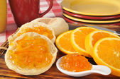 Orange marmalade on an English muffin — Stock Photo