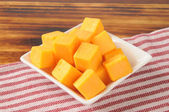 Cheddar cheese cubes — Stock Photo
