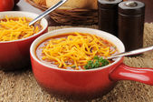 Chili con carne topped with cheese — Stock Photo
