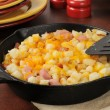 Diced ham and potatoes with cheddar cheese — Stock Photo