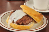 Sausage and biscuits with gravy — Stock Photo