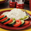 Cottage cheese with cucumber and tomato — Stock Photo