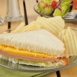 Baloney sandwich with chips — Stock Photo