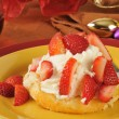 Strawberry shortcake on a holiday table — Stock Photo