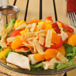 Salad with tropical fruit and chicken — Stock Photo