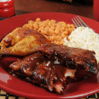 Barbecued ribs and chicken — Stock Photo