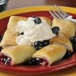 Stock Photo: Blueberry blintzes with shipped cream