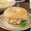 Tuna sandwich on a bagel with soup — Stock Photo