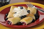 Blueberry blintzes with shipped cream — Stock Photo