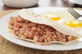 Corned beef hash breakfast burrito — Stock Photo