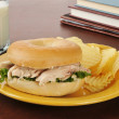 Chicken sandwich on a bagel after school — Stock Photo