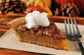 Pecan pie with whipped cream — Stock Photo