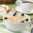 Brown rice with milk and a muffin — Stock Photo